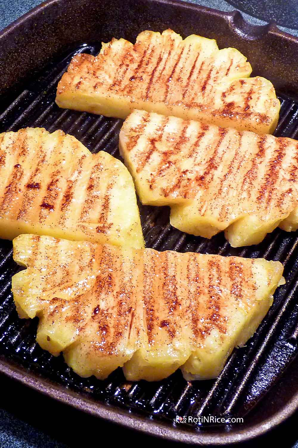 Grilled Pineapple in a cast iron grill pan.