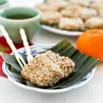 Chewy and fragrant Steamed Nian Gao with Grated Coconut and Sesame Seeds, a twist on this popular dessert enjoyed during the Chinese New Year. | RotiNRice.com