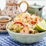 Cook your own Pad Thai, one of Thailand's most popular noodle dishes. This tasty version comes with chicken, shrimps, egg, bean sprouts, and peanuts. | RotiNRice.com