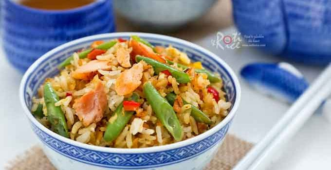 Simple and tasty Salmon Fried Rice using leftover grilled salmon, green beans, and eggs. Red chili peppers provide a little heat. | RotiNRice.com