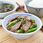Thin slices of juicy beef are paired with tender crisp asparagus in this quick and easy Sesame Beef Asparagus Stir Fry. Perfect for weeknight meals! | RotiNRice.com #beefrecipes #asparagusrecipes #stirfryrecipes
