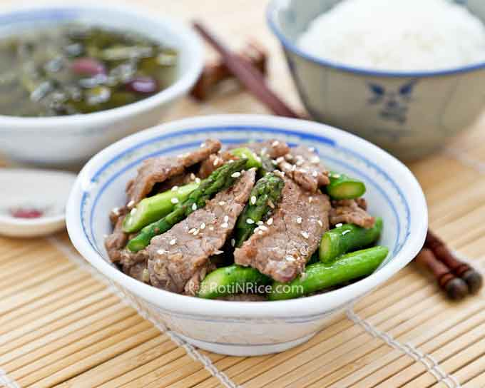 Thin slices of juicy beef are paired with tender crisp asparagus in this quick and easy Sesame Beef Asparagus Stir Fry. Perfect for weeknight meals! |  RotiNRice.com