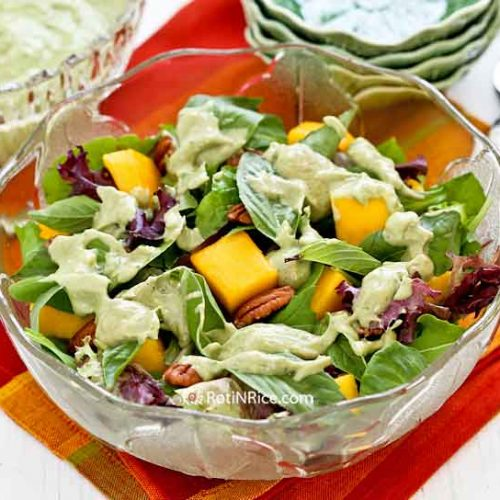 Tickle your taste buds with this Mango Pecan Salad with Creamy Basil Avocado Dressing. It is sweet, tangy, and refreshing with a delightful crunch.   RotiNRice.com