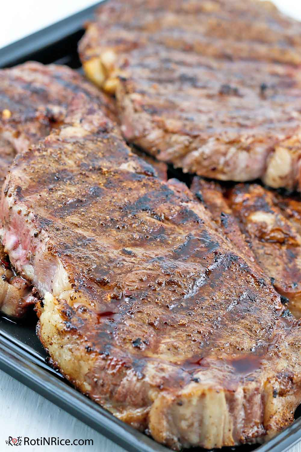 Grilled New York Strip Steaks with Homemade Spice Rub hot off the grill.