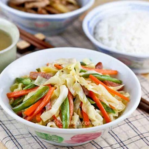 Easy Ham Cabbage Stir Fry with a nice balance of saltiness from the ham and sweetness from the cabbage, carrots, and green beans. | RotiNRice.com