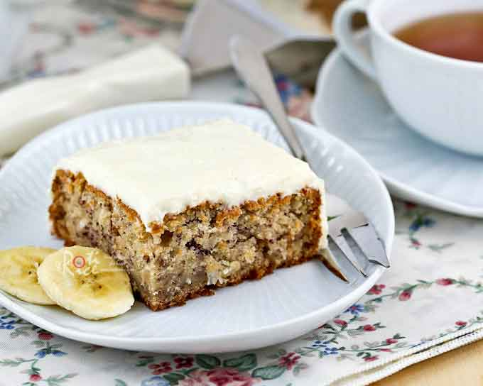 Rich and moist Banana Coconut Cake with Cream Cheese Frosting, perfectly satisfying for mid-morning snack or delicious tea time treat. | RotiNRice.com
