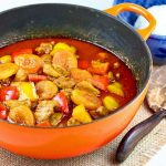 Creamy Chicken Apricot Curry with mildly sweet accents from dried apricots, red, and yellow bell peppers. Enjoy this one-pot dish with steamed rice. | RotiNRice.com