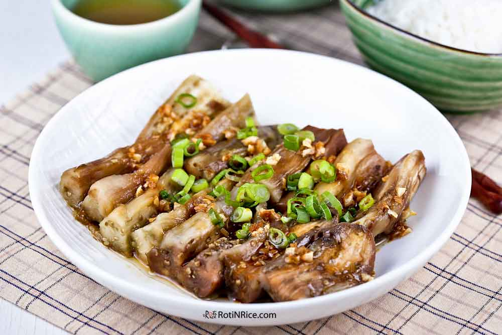 Roasted Eggplant with Garlic Soy Dressing served with steamed rice.