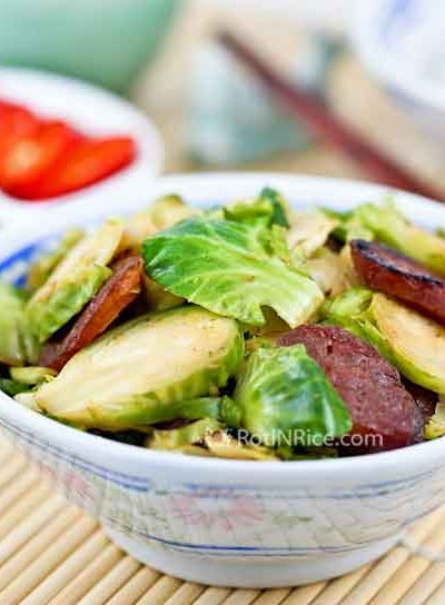 Tasty Brussels Sprouts and Sausage Stir Fry combining Chinese sausage and soy sauce to give it an Asian flavor. Wonderful served as a side dish. | RotiNRice.com
