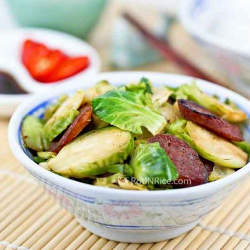Tasty Brussels Sprouts and Sausage Stir Fry combining Chinese sausage and soy sauce to give it an Asian flavor. Wonderful served as a side dish.   RotiNRice.com