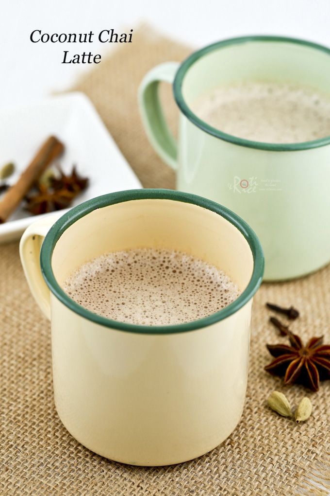 Warm, creamy Coconut Chai Latte infused with cinnamon, star anise, cloves, and cardamom. So delicious topped with frothy coconut milk. | Food to gladden the heart at RotiNRice.com