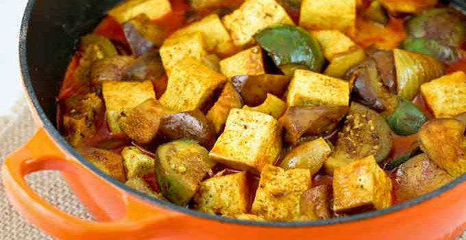 This easy to prepare Tofu Eggplant Curry is delicious and flavorful. Serve it with rice for a satisfying vegetarian meal.   RotiNRice.com