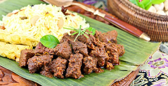 Rich and fragrant Beef Rendang with an incredible depth of flavor. It is an aromatic caramelized beef curry traditionally served during festive occasions. | RotiNRice.com #beefrendang #rendang #beefcurry