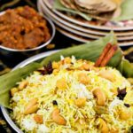 Nasi Biryani/Briyani topped with fried shallots and cashews.