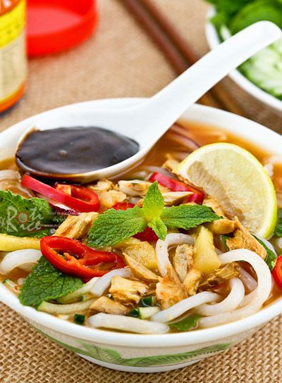 Asam Laksa is a flavorful, tangy, and spicy Malaysian fish based rice noodle soup. It is a dish not to be missed when visiting Malaysia. | RotiNRice.com #asamlaksa #laksa #penanglaksa