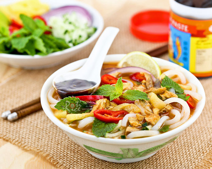 Asam Laksa is a flavorful, tangy, and spicy Malaysian fish based rice noodle soup. It is a dish not to be missed when visiting Malaysia. | RotiNRice.com