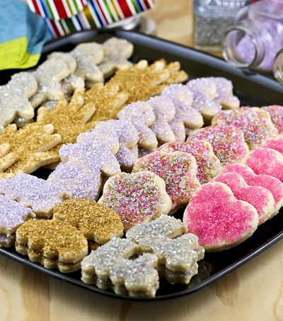 These fun Sugar Cookies are buttery, eggless, and easy to handle. Only 5 ingredients and your choice of shapes and sprinkles.   Food to gladden the heart at RotiNRice.com