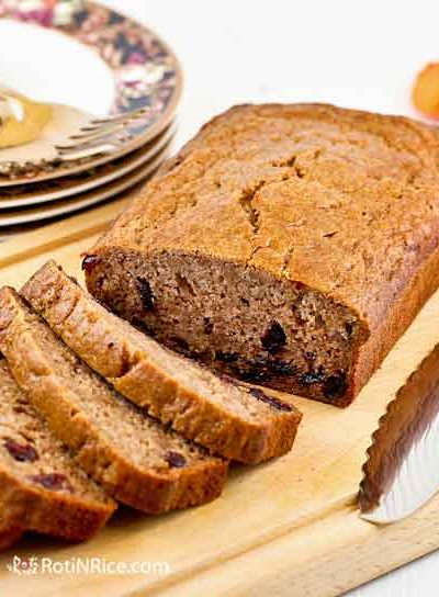 Celebrate fall with this warmly spiced brown sugar Persimmon Cranberry Bread. Deliciously moist and satisfying for breakfast or tea time. | RotiNRice.com #persimmonbread #persimmonrecipes #quickbreads #quickbreadrecipes