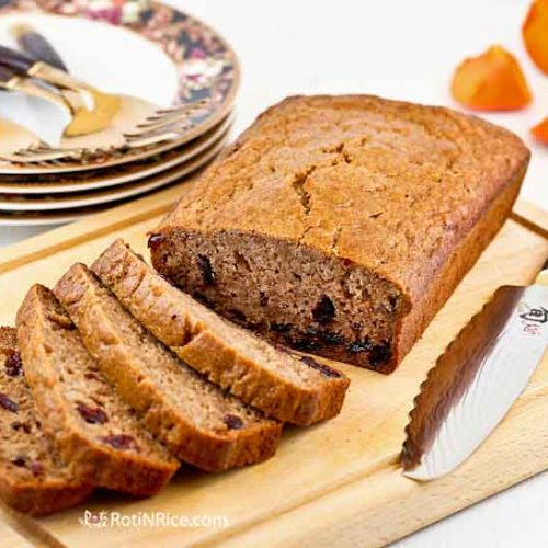Celebrate fall with this warmly spiced brown sugar Persimmon Cranberry Bread. Deliciously moist and satisfying for breakfast or tea time.   RotiNRice.com #persimmonbread #persimmonrecipes #quickbreads #quickbreadrecipes