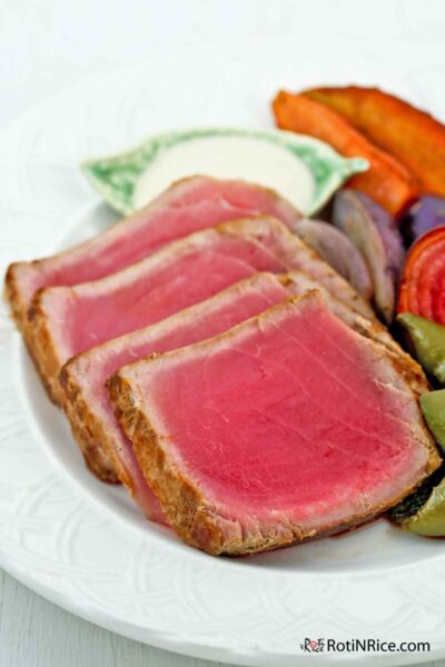 Seared Tuna served with roasted vegetables.