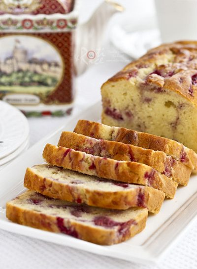 This fine textured Raspberry Swirl Cream Cheese Pound Cake is perfect for tea time or the holidays. It is wonderfully fragrant, moist, and delicious. | RotiNRice.com #poundcake #creamcheese #raspberry #cakerecipes
