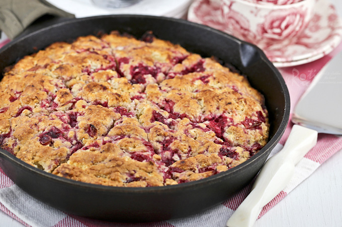 Use your leftover cranberry sauce to make these soft, tender Cranberry Sauce Skillet Scones. They are delicious served with whipped cream and a cup of tea. | RotiNRice.com