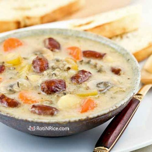 This Creamy Sausage Vegetable Soup is especially warm and comforting on chilly days. It is delicious served with crusty bread. | RotiNRice.com #sausagesoup #souprecipes
