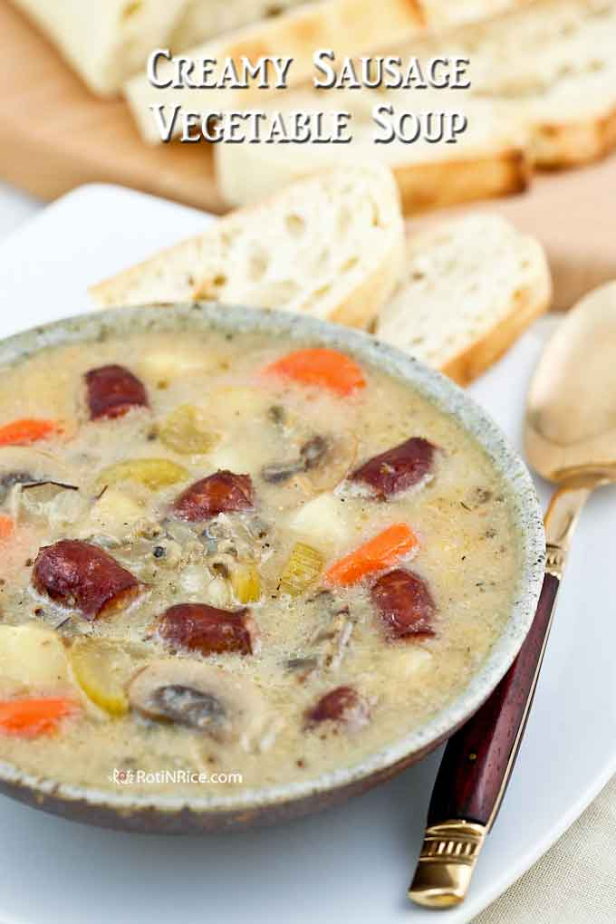 Creamy Sausage Vegetable Soup served with crusty bread