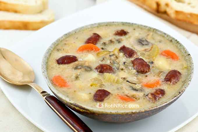 Creamy soup served with crusty bread