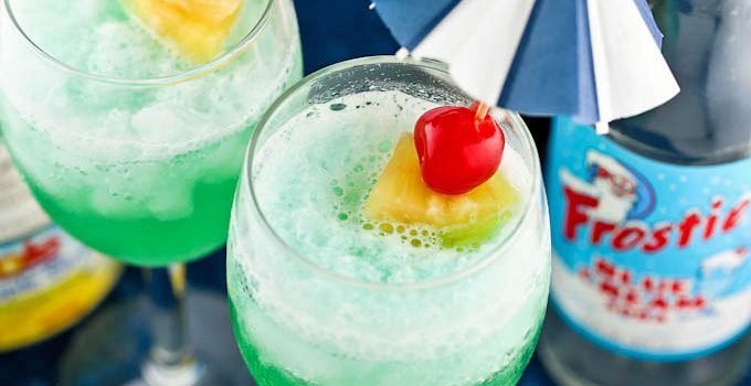 This cool Blue Hawaiian Mocktail is a fun drink to prepare for any occasion. Only 3 ingredients and some crushed ice are needed. | RotiNRice.com #bluehawaiian #mocktail