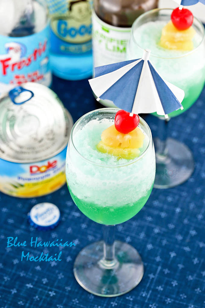 Blue Hawaiian Mocktail with an umbrella pick.