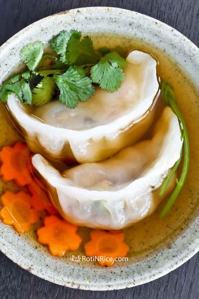 Crystal skin Shrimp Dumpling served in shallow bowl.