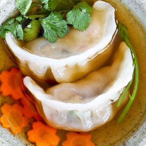 Crystal skin Shrimp Dumpling served in shallow bowl.
