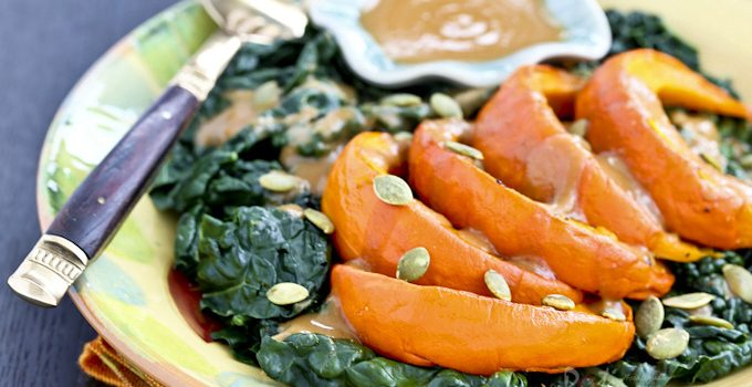 Healthy and warm Kabocha Kale Salad with Miso Butter Sauce, perfect for cooler evenings and days. Toasted pumpkin seeds provide crunch and texture. | RotiNRice.com