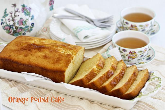 Sliced cake served with tea.