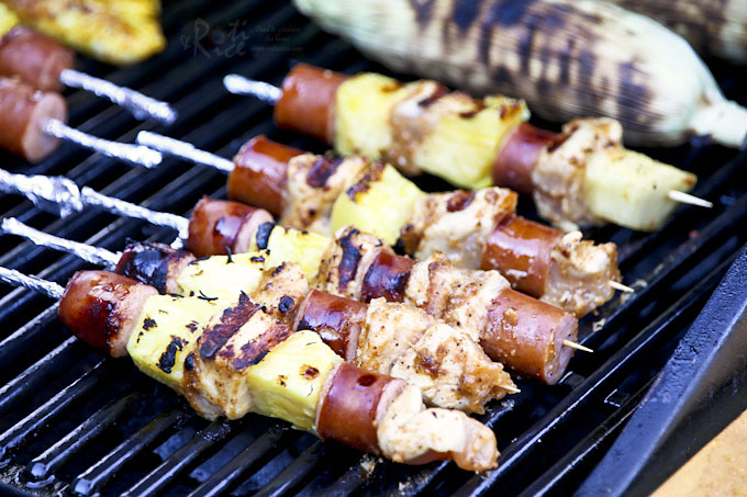 Fire up the grill for these colorful and tasty Chicken Pineapple Sausage Kabobs with a peanut butter hot sauce marinade. They are quick, easy, and delicious. | RotiNRice.com
