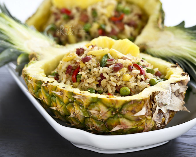 Pineapple Ham Fried Rice with a combination of sweet, salty, and fruity flavors that is sure to please. Serve it in a pineapple boat to wow and impress! | RotiNRice.com