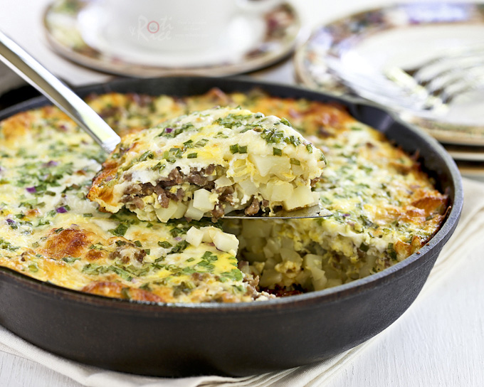 Wake up to this delicious Sausage, Potato, and Egg Skillet topped with shredded cheese and green onions. Makes a wonderful weekend breakfast or brunch treat for the family. | Food to gladden the heart at RotiNRice.com