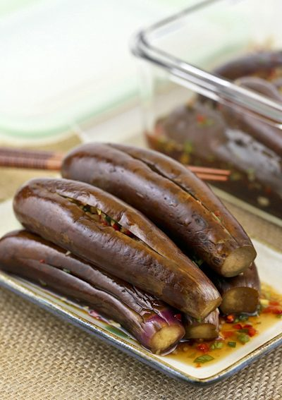 These tangy and spicy Pickled Stuffed Eggplants make a wonderful condiment or side dish. They whet your appetite and are delicious served with steamed rice. | RotiNRice.com