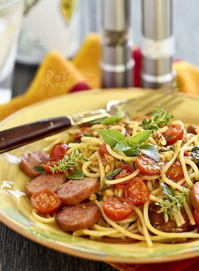 Quick and easy Pasta with Fresh Herbs, Sausage, and Tomatoes perfect for busy weeknights. Dinner can be ready in less than 30 minutes. | RotiNRice.com #pasta #spaghetti #freshherbs