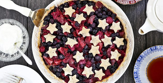 Delicious Triple Berry Tart with flaky hazelnut crust and juicy blueberries, strawberries, and raspberries filling. Recipe includes gluten free option. | Food to gladden the heart at RotiNRice.com
