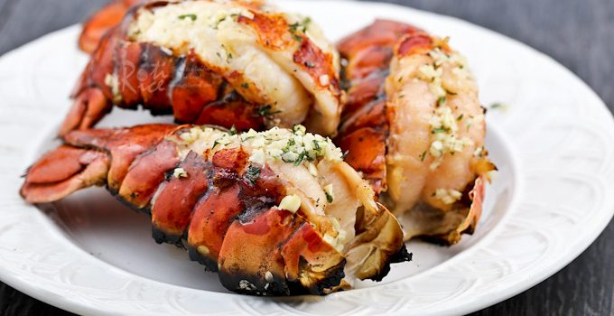 These Grilled Lobster Tails are the ultimate appetizers. Only minutes to prepare and absolutely delicious hot off the grill. | RotiNRice.com #lobstertails #lobsters #grilledlobsters