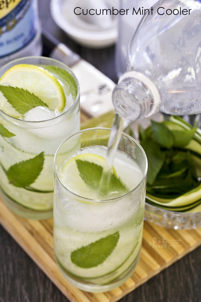 Cucumber Mint Cooler topped with your choice of club soda, seltzer, or water, and a squeeze of lime juice. It's cool, fizzy, and super refreshing.| RotiNRice.com