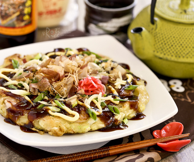 Okonomiyaki topped with bonito shavings, mayonnaise, and Okonomiyaki sauce.