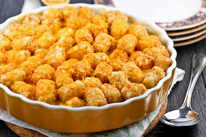This Cheesy Meatball Tater Tot Casserole is comfort food for the meat and potato lover. It is warm, delicious, satisfying, and so easy to prepare. | RotiNRice.com #meatballs #tatertot #casseroles #meatballrecipes