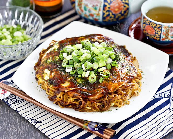 Hiroshima Style Okonomiyaki (Japanese Layered Pancakes) - the ultimate savory pancake complete with cabbage, bacon, noodles, shrimp, and egg. So yummy! | RotiNRice.com #hiroshimaokonomiyaki #okonomiyaki #japanesepancake