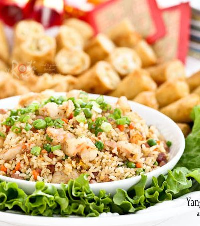 Yang Chow Fried Rice, a popular fried rice cooked with ham, shrimps, carrots, green peas, and eggs. Delicious served with egg rolls. | RotiNRice.com #friedrice #hamfriedrice #shrimpfriedrice