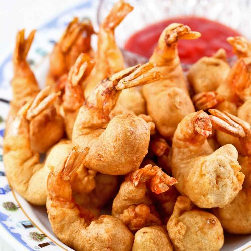 Golden Shrimp Puffs (Shrimp Fritters) served with sweet chili sauce.