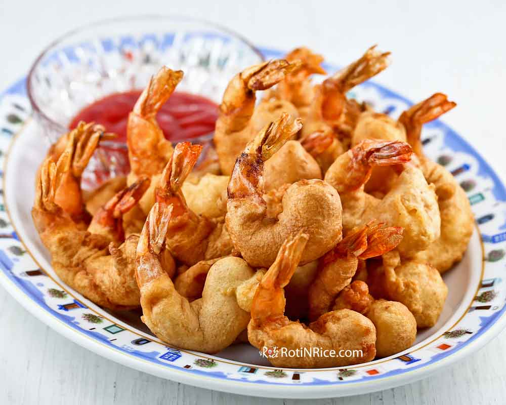 Tantalizing Golden Shrimp Puffs (Shrimp Fritters) served with sweet chili sauce.
