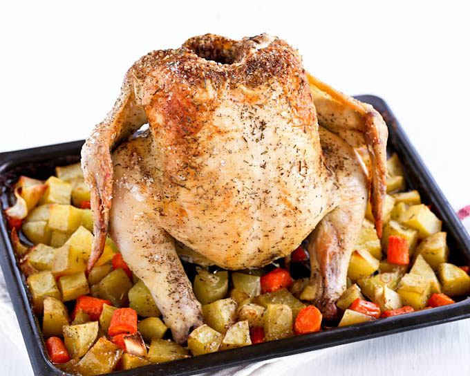 This crispier skin Roast Chicken with Carrots and Potatoes is an all time favorite one-pan meal perfect for any time of the year.| RotiNRice.com